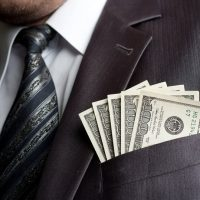 Businessman with one hundred dollars in pocket