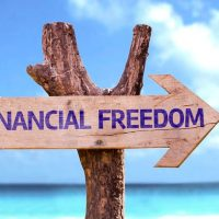 Financial freedom sign on beach