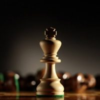 Wooden chess king on board