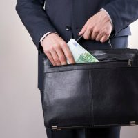 Businessman with briefcase and $100 bill