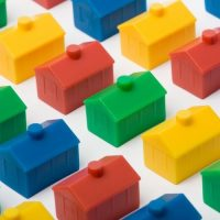 Colorful plastic model monopoly houses