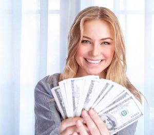 Woman holding fan of cash