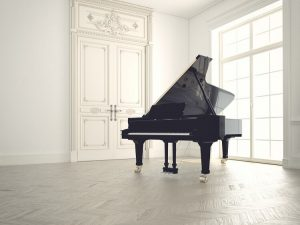 Grand piano in an empty room